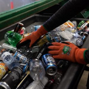 person counting recyclables