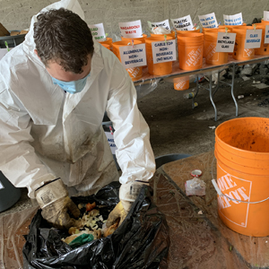 man working with compost