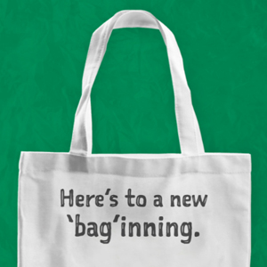 reusable bag with heres to new baginnings written on it